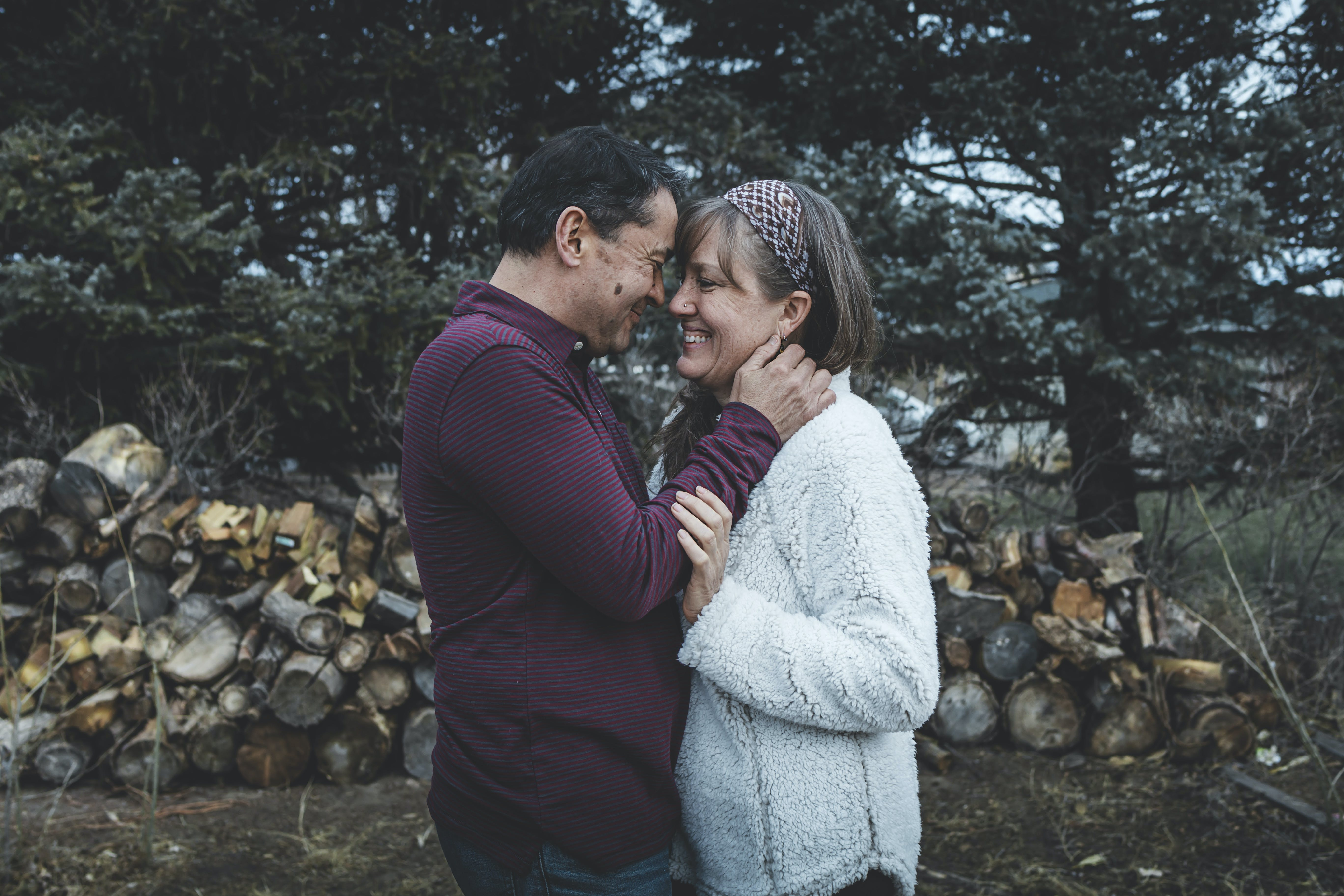 Man and Woman Face to Face Beside Tree