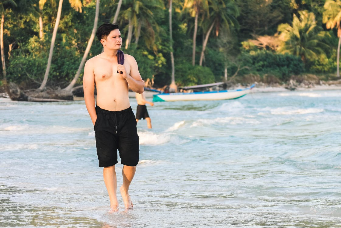 asiatisk mann, hav, havkyst