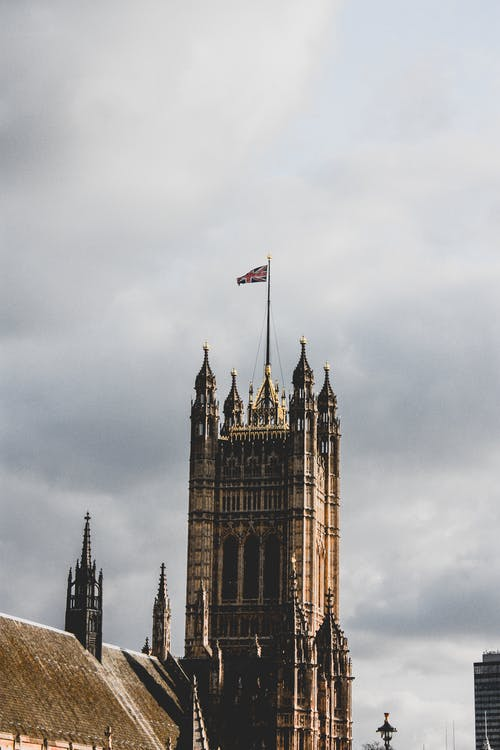 Low Angle Photography of Castle With Uk Flag