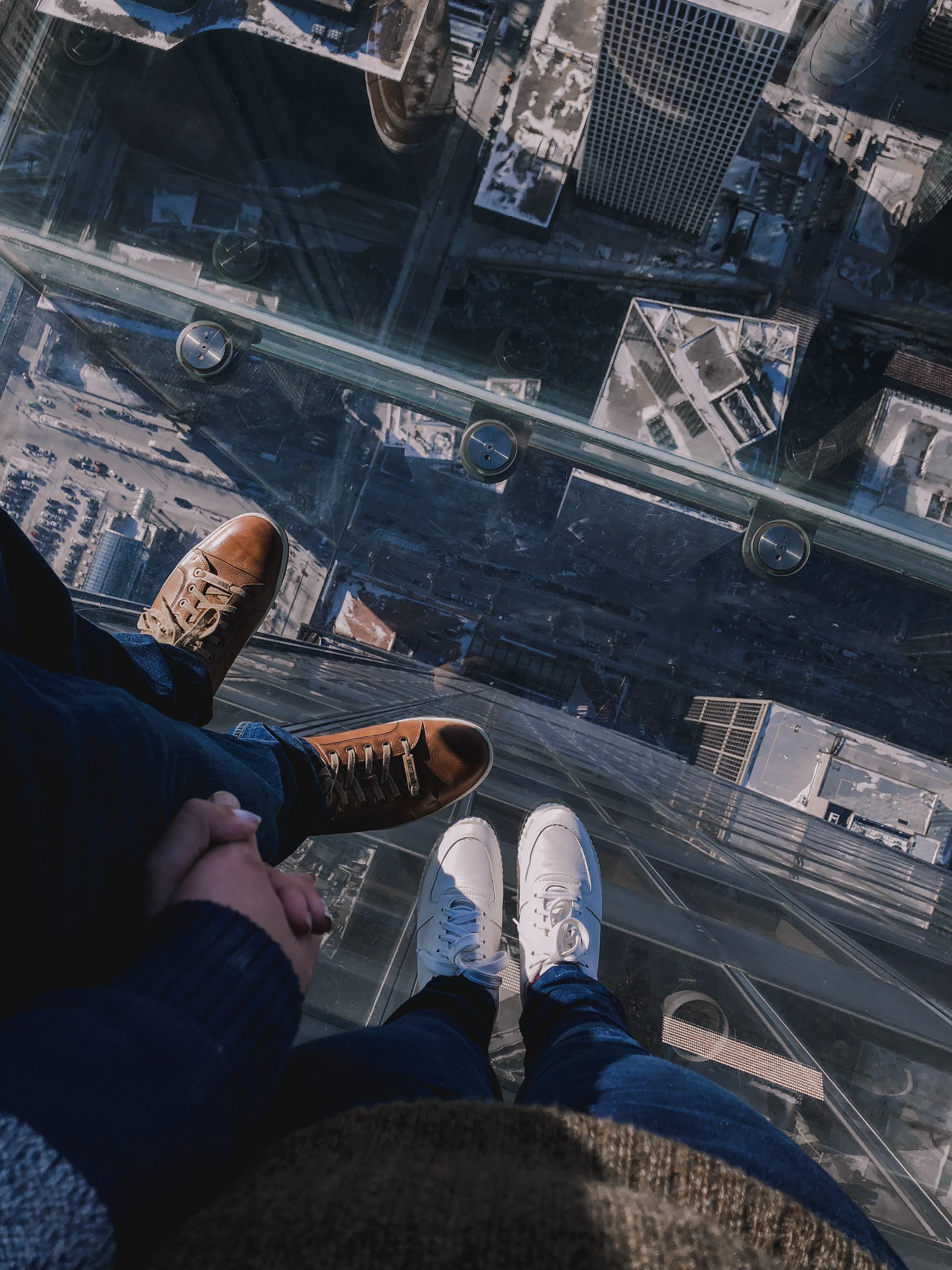 People Standing On Top Of A Building