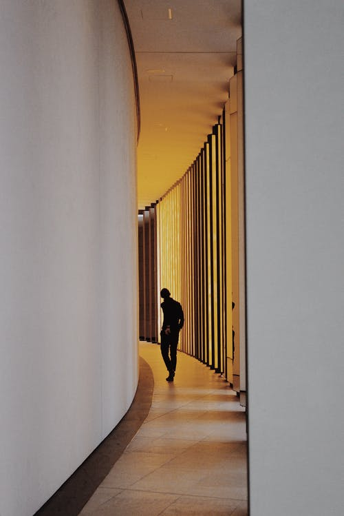 Person Standing on Hallway
