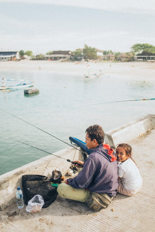 Man and Child Fishing