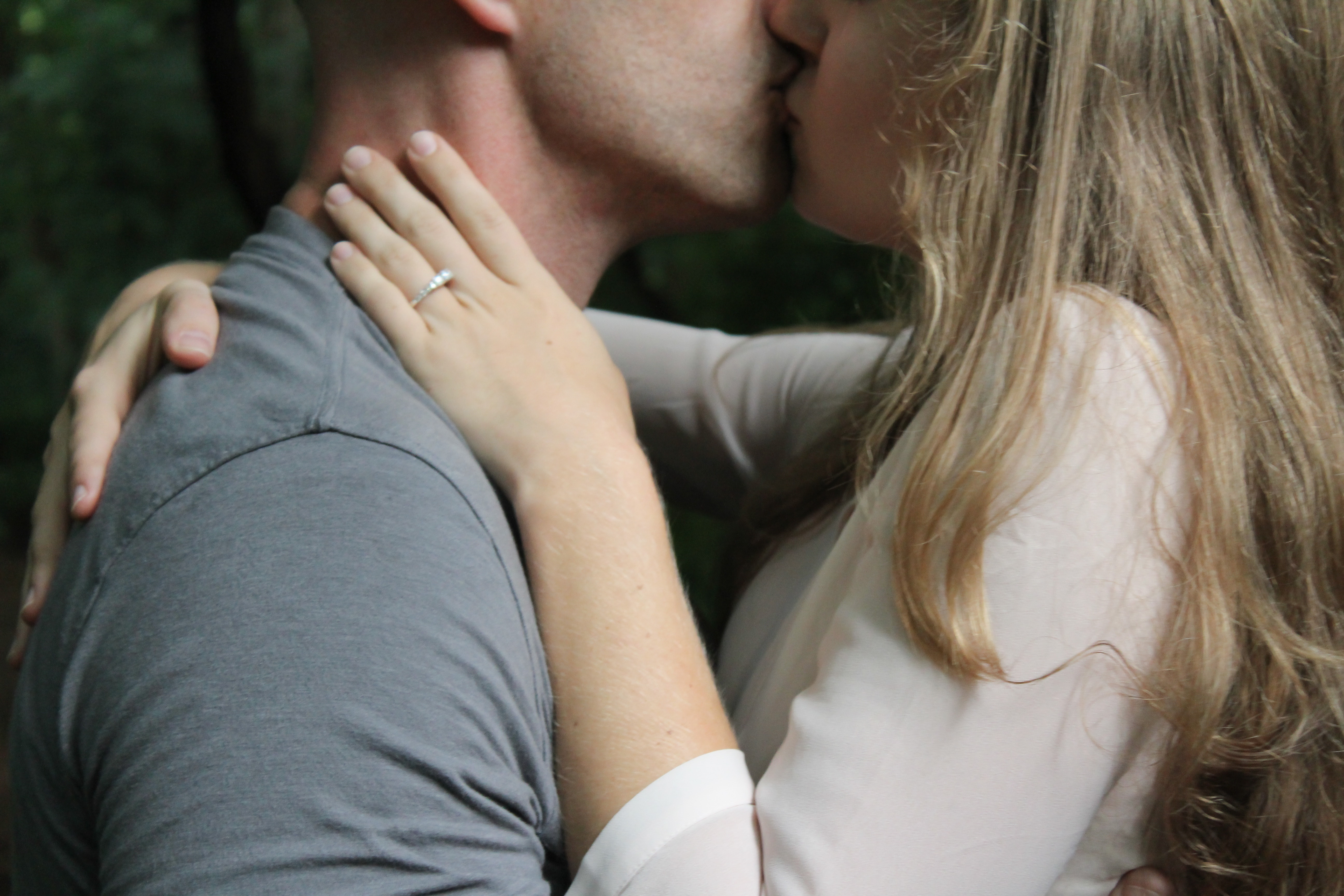 A man and a woman kissing without dress