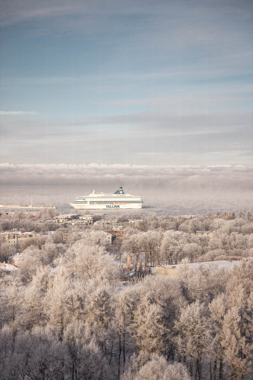 Winter landscape of snowy terrain with ship
