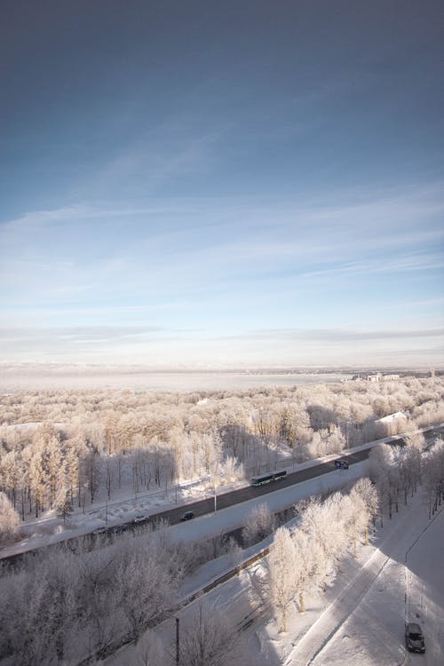 Vehicles Passing on Snow Covered Road