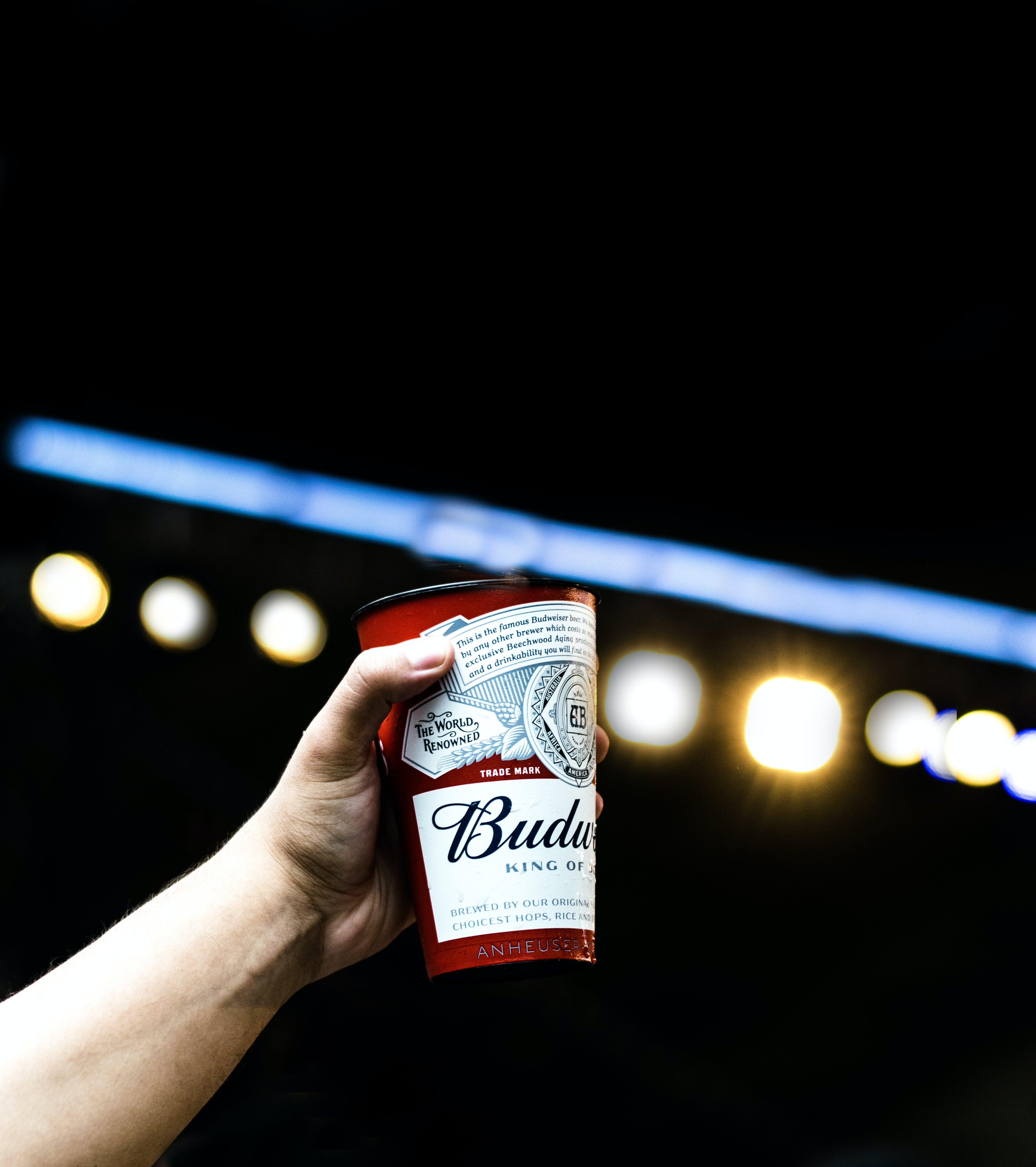 Person Holding Budweiser Cup