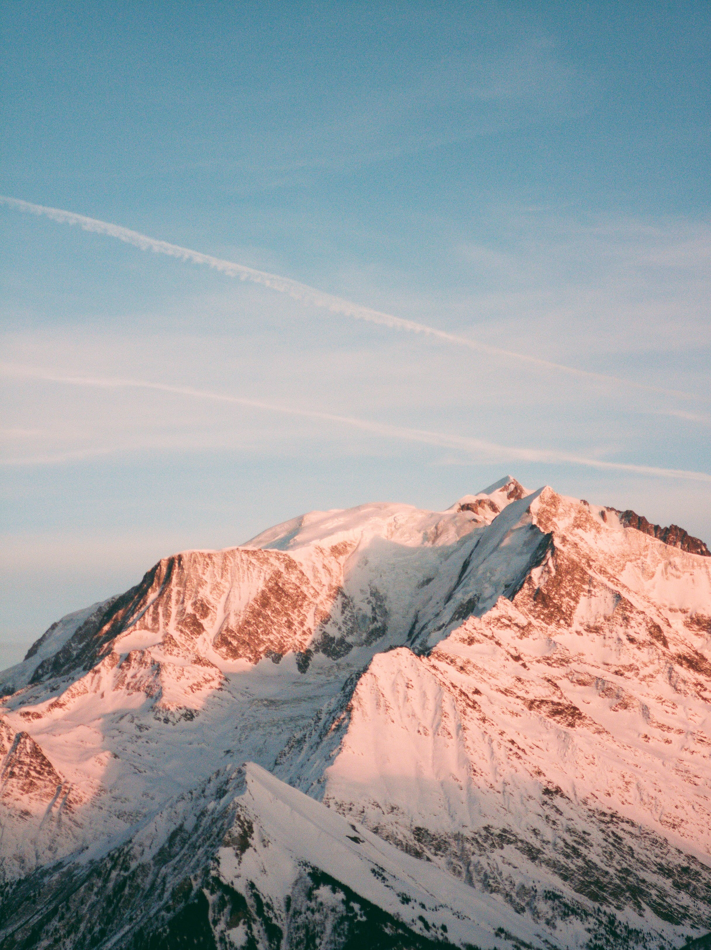 Photo of Snow Capped Mountain Under Blue Sky