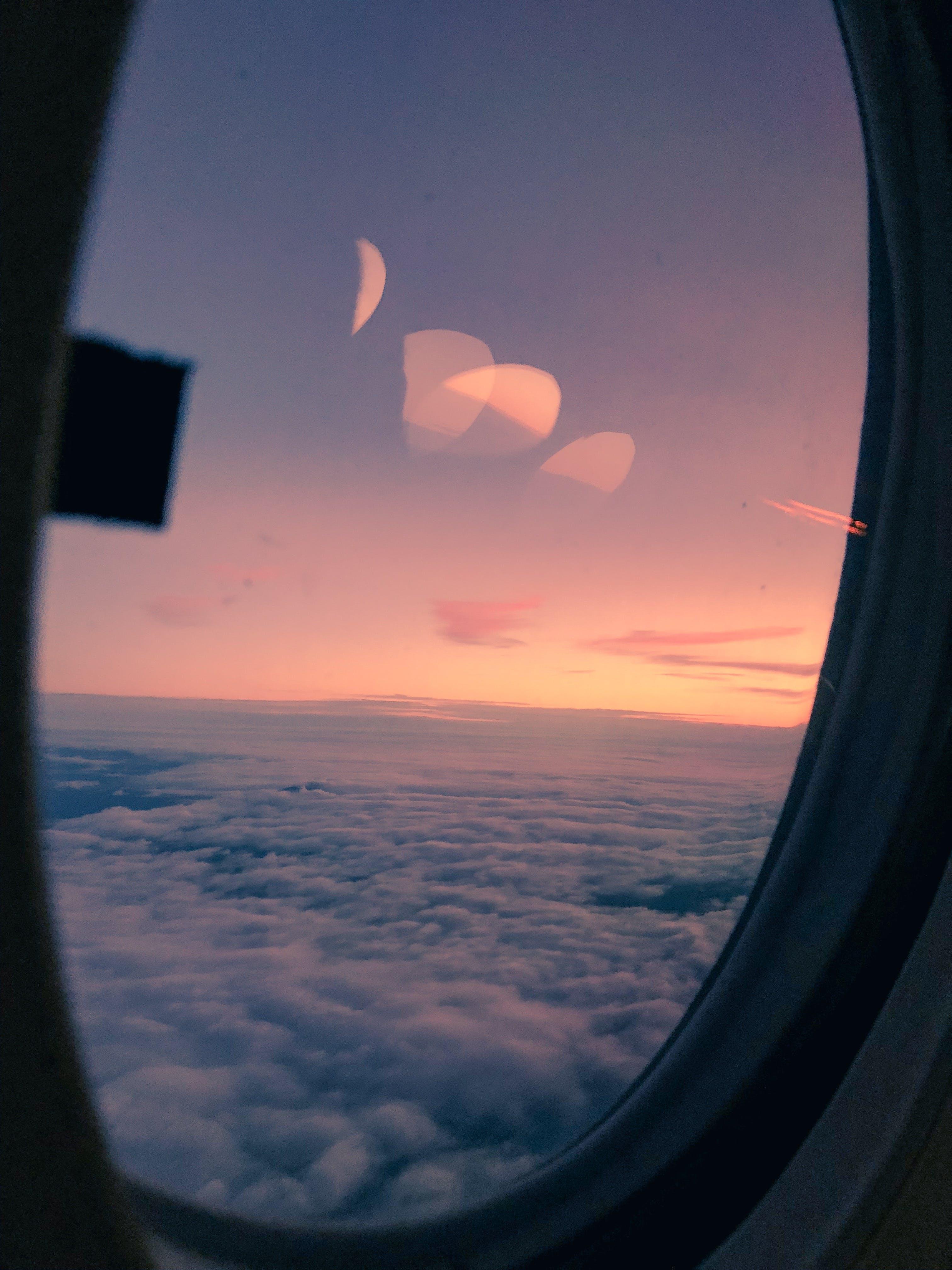 Kostenloses Stock Foto zu atmosphäre, aviate, bewölkt, dämmerung