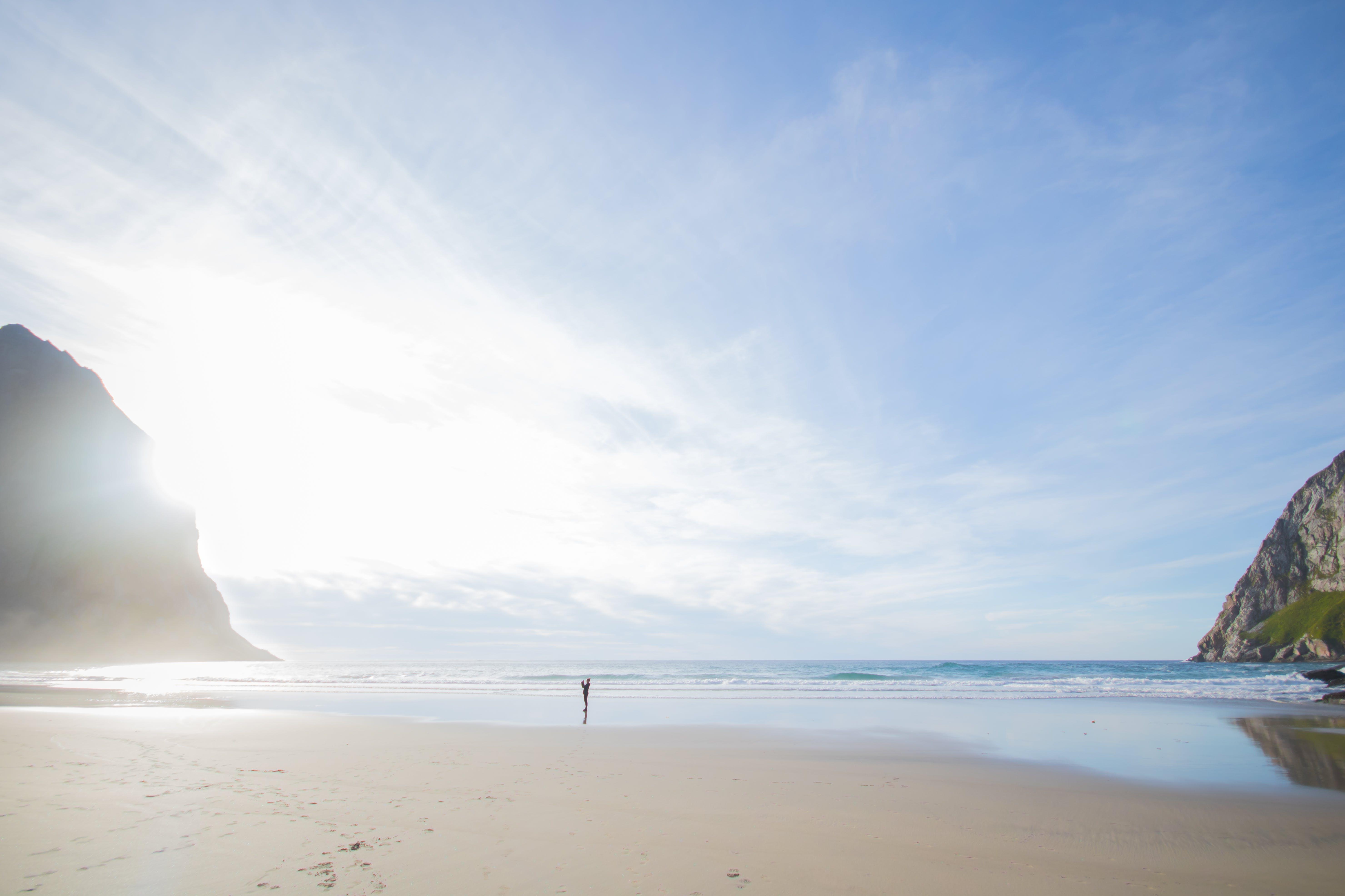 Person Walking at the Beach Seen Afar