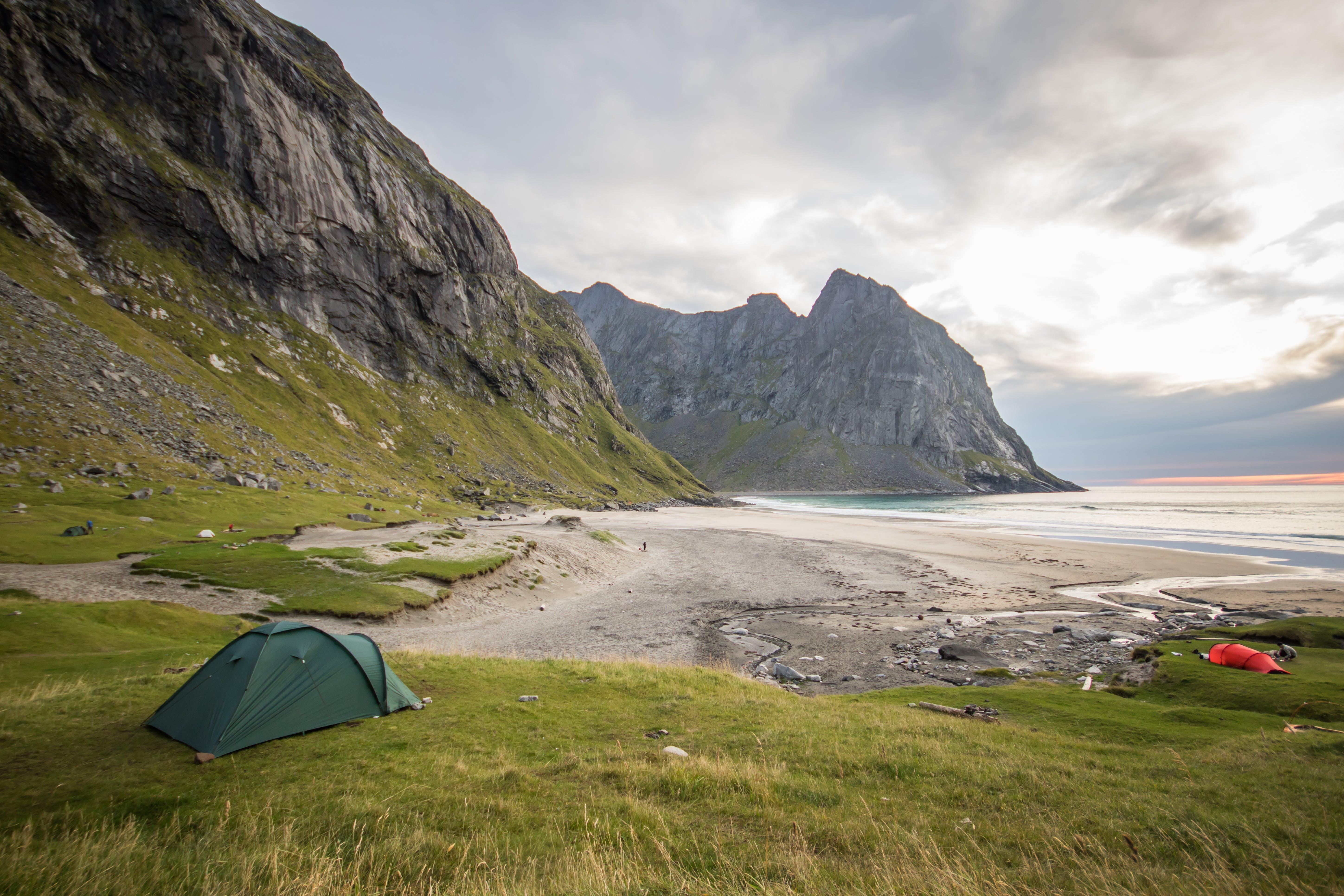 Green Tent on Green Grass Field Facing Ocean
