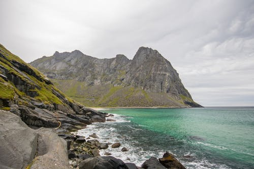 Free stock photo of coulds, green, Nordic beach, rocks
