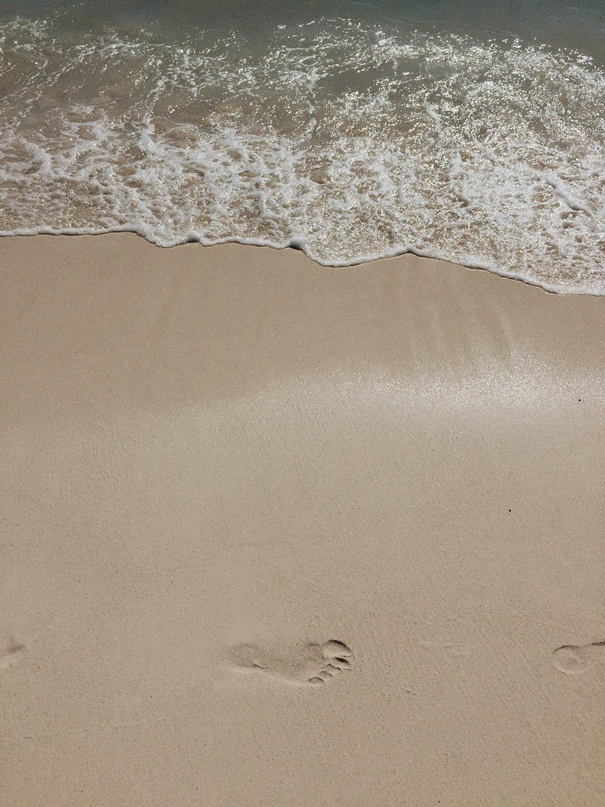 Kostenloses Stock Foto zu ferien, fußabdrücke, küste, meer