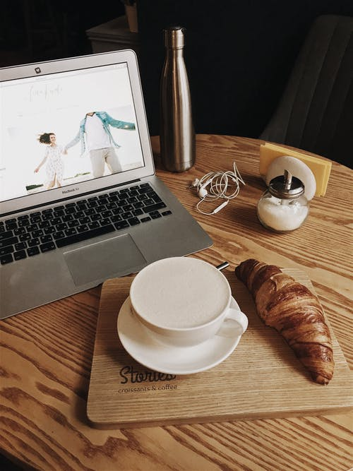 Macbook Pro Beside Teacup
