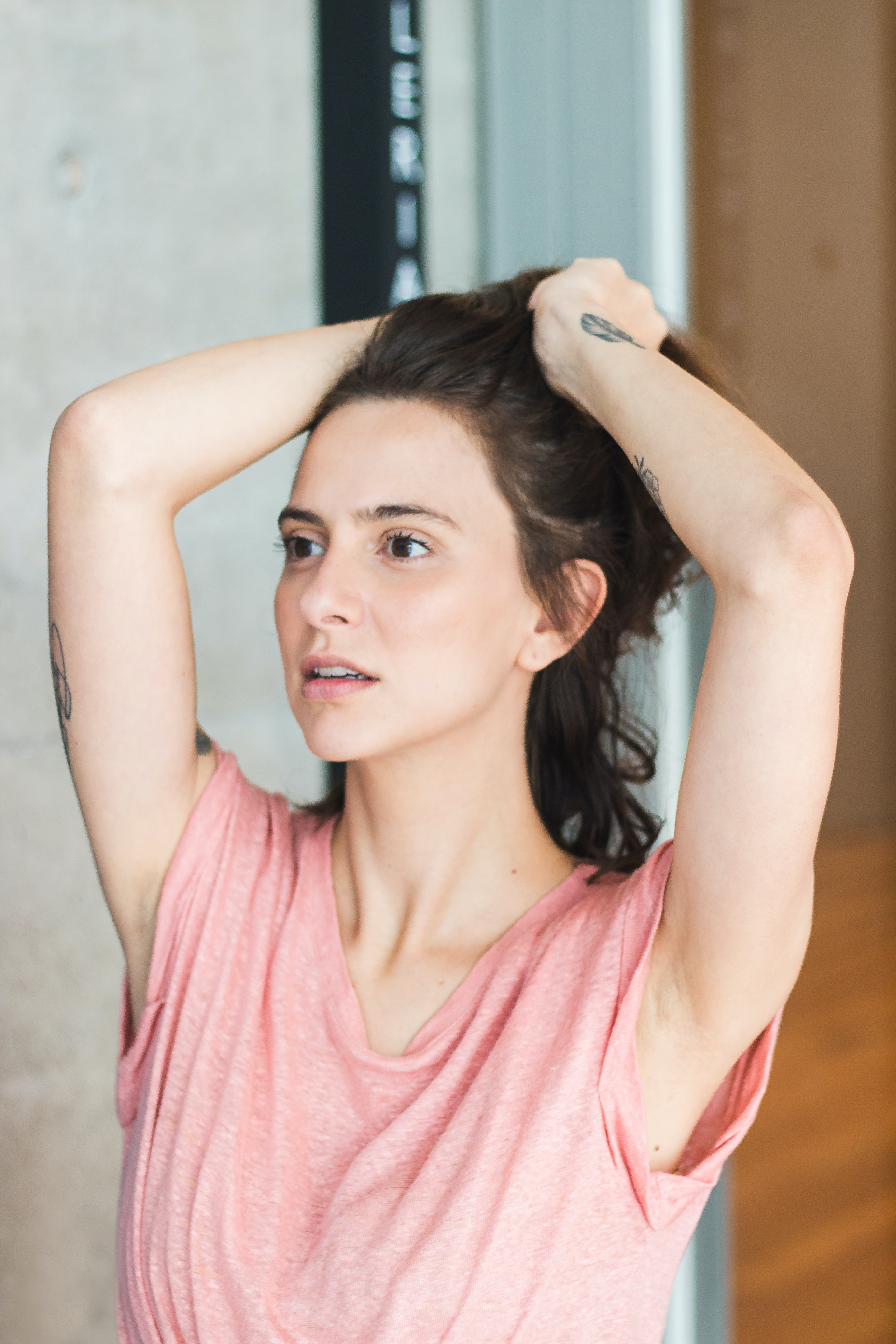 Woman Holding Her Hair Posing