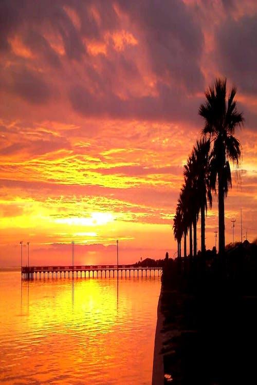 Foto d'estoc gratuïta de #nature #sky #clouds #sun #water #ocean #sunset