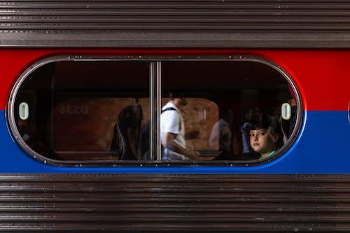 Man in Black Jacket Sitting on Train