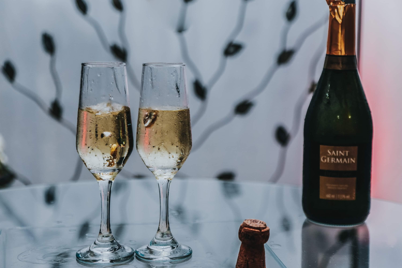Two Glasses of Wines Beside Bottle