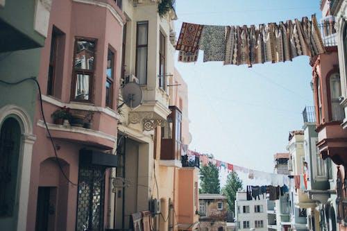 Textiles Hanging Between Houses