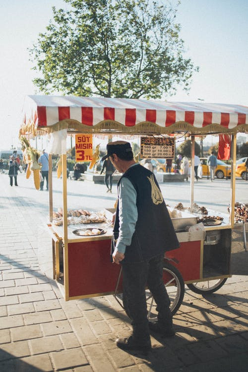 Man Cooking On Portable Food Stall