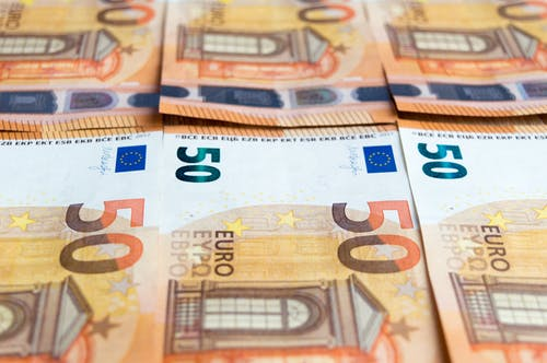 50 Euro Bill on Brown Wooden Table