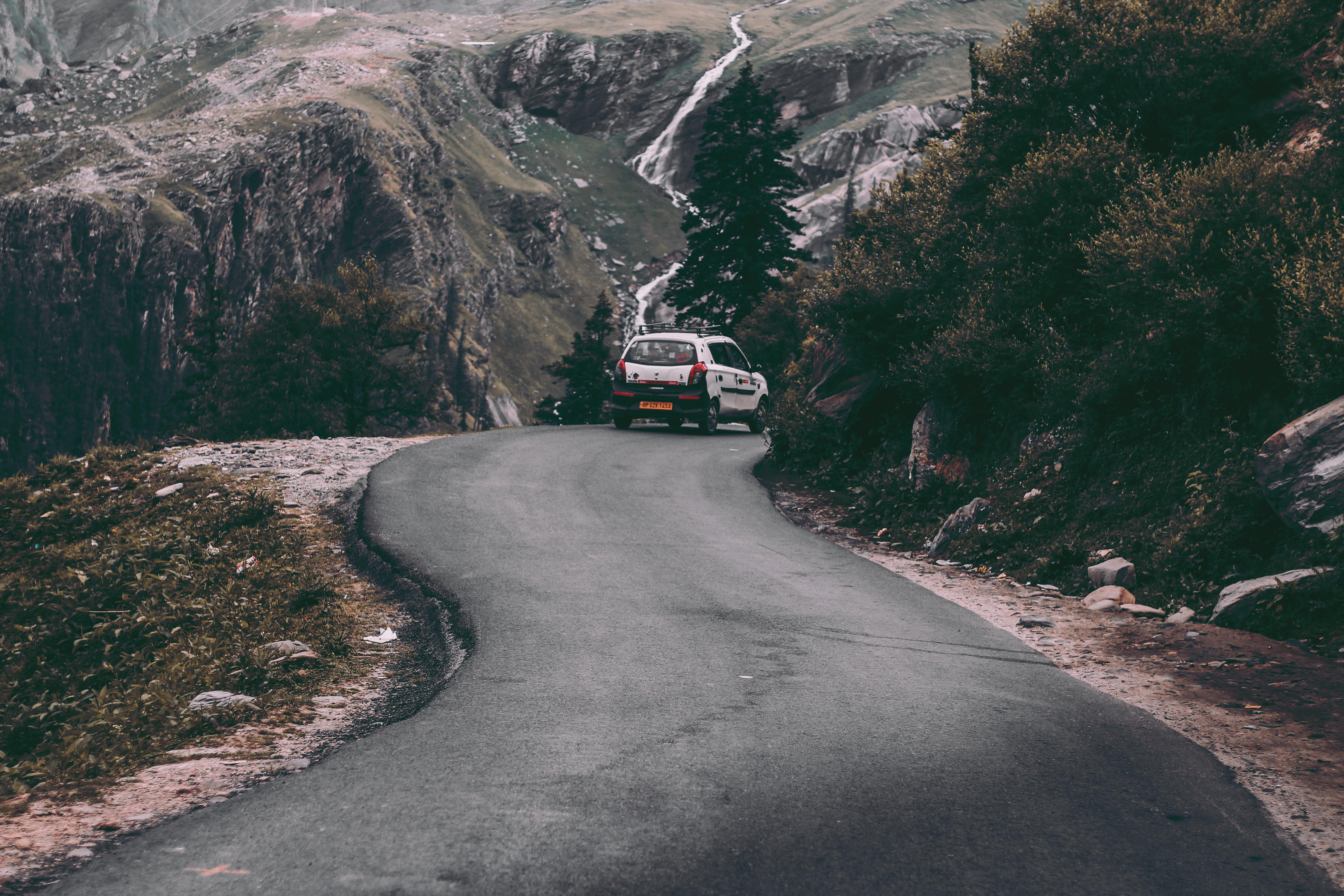 Vehicle on Road Near Mountain