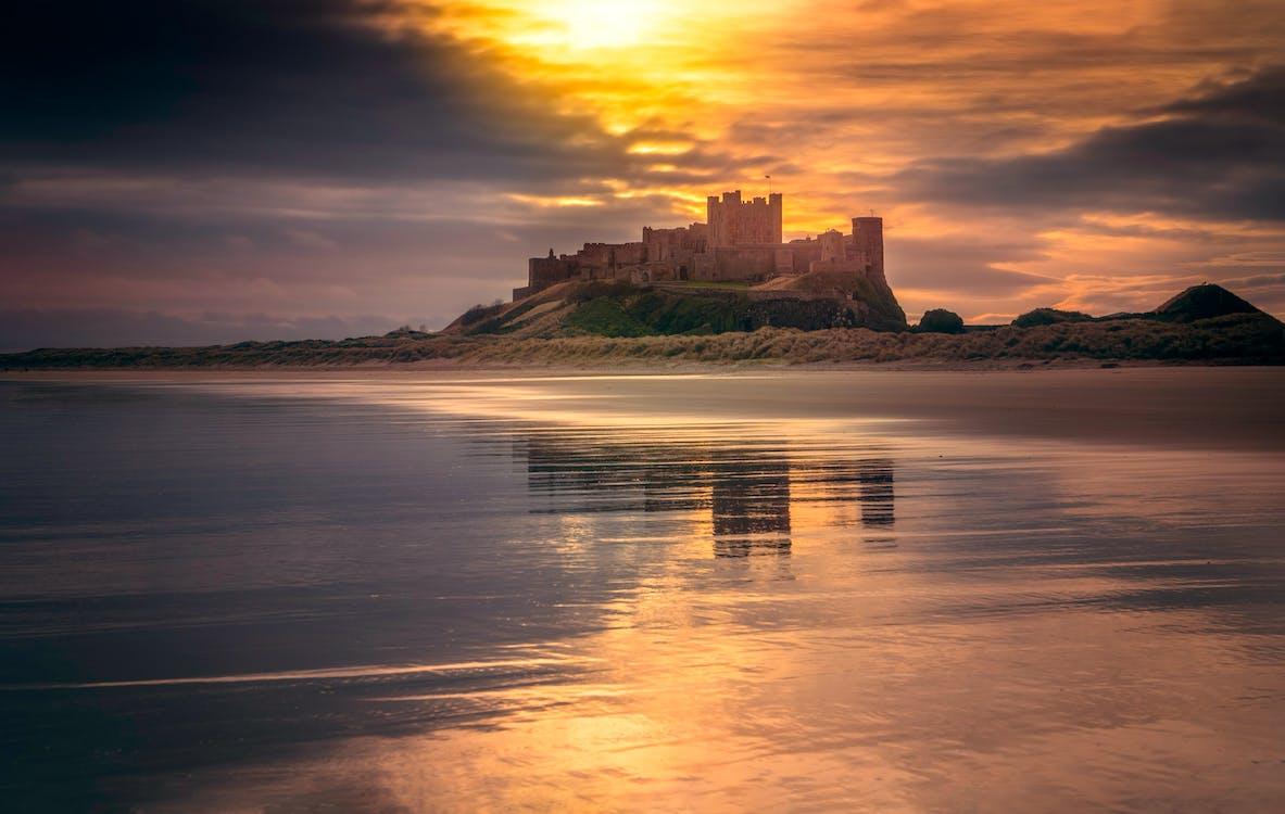 Castle Near Body of Water Under Golden Hour