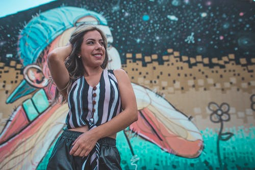 Standing Woman Front of Graffiti Wall
