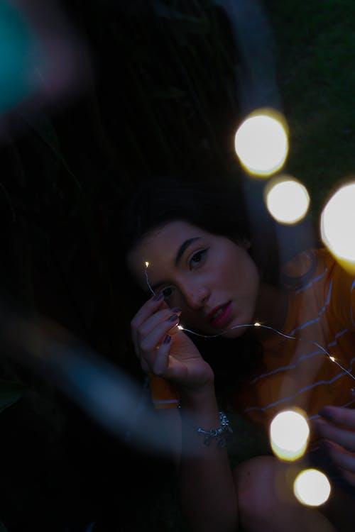 Photo Of Girl Holding String Lights