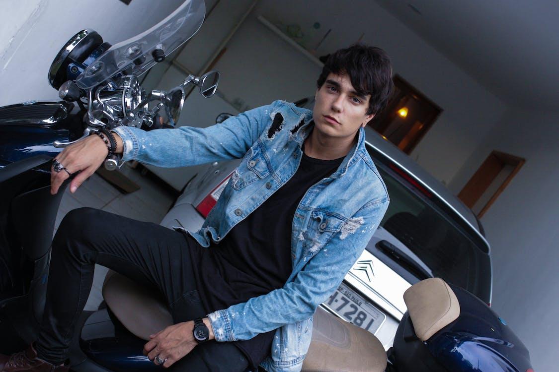 Photo of Man Sitting On Motorcycle