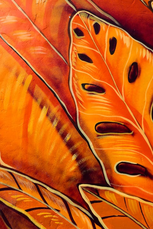 Close-up Photo Of A Painting Of Orange Leaves