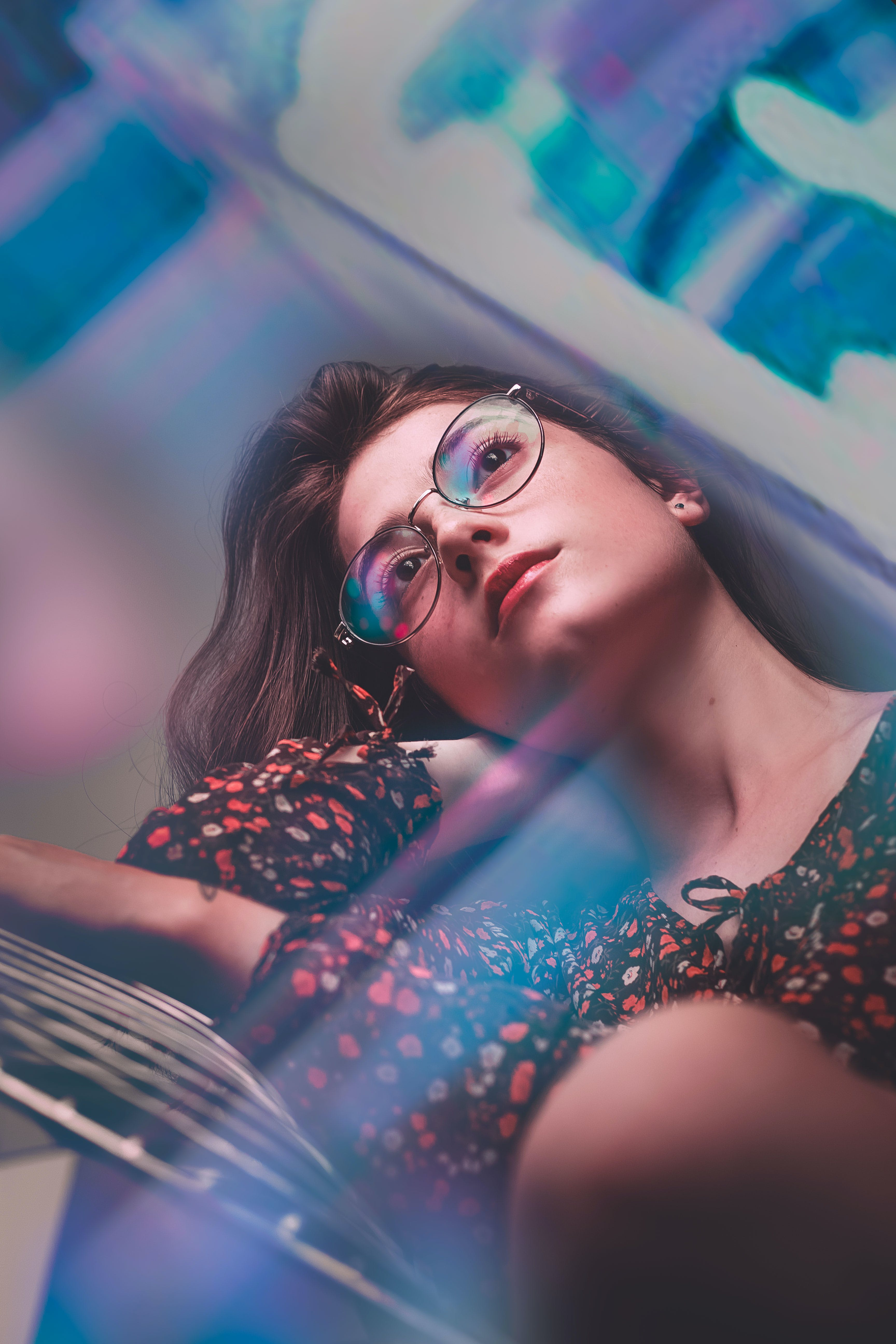 Selective Focus Photo of Woman Wearing Eyeglasses and Floral Top