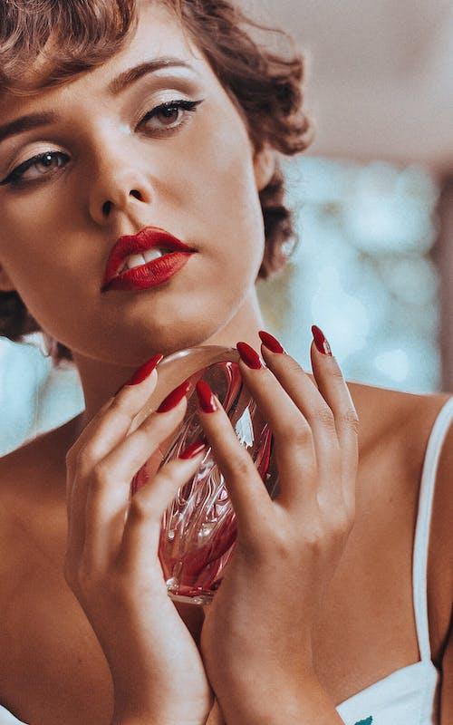 Woman Holding Glass Decor