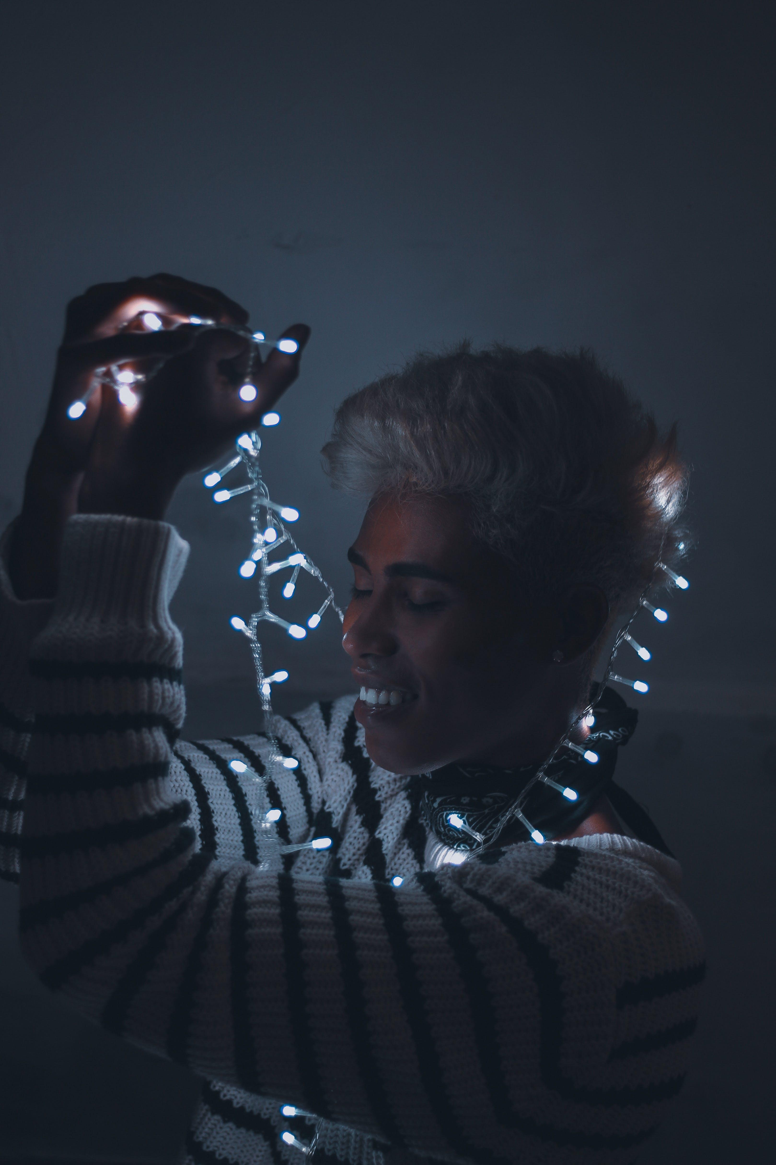 Man Holding Fairy Lights