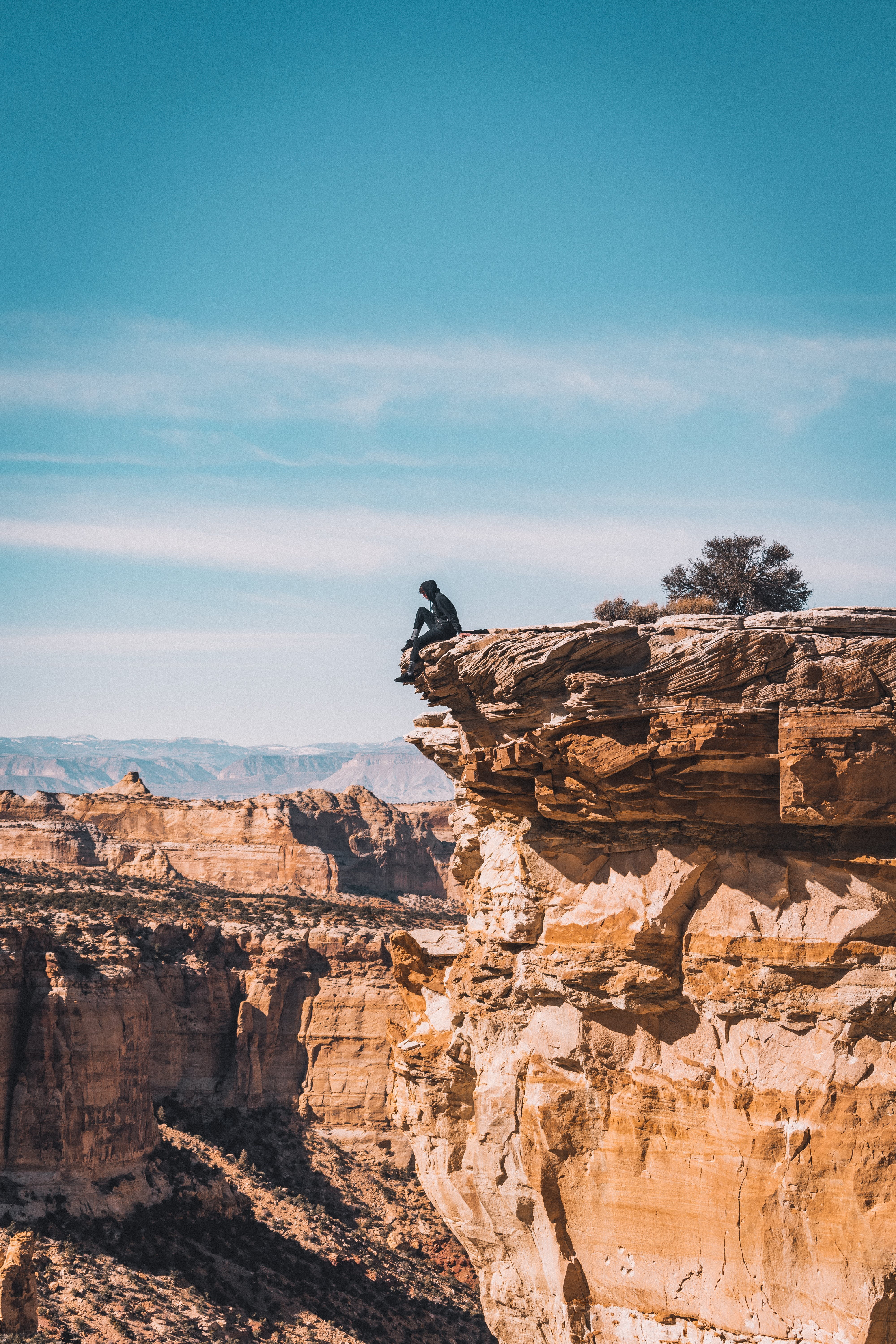 Man Sitting At The Cliff