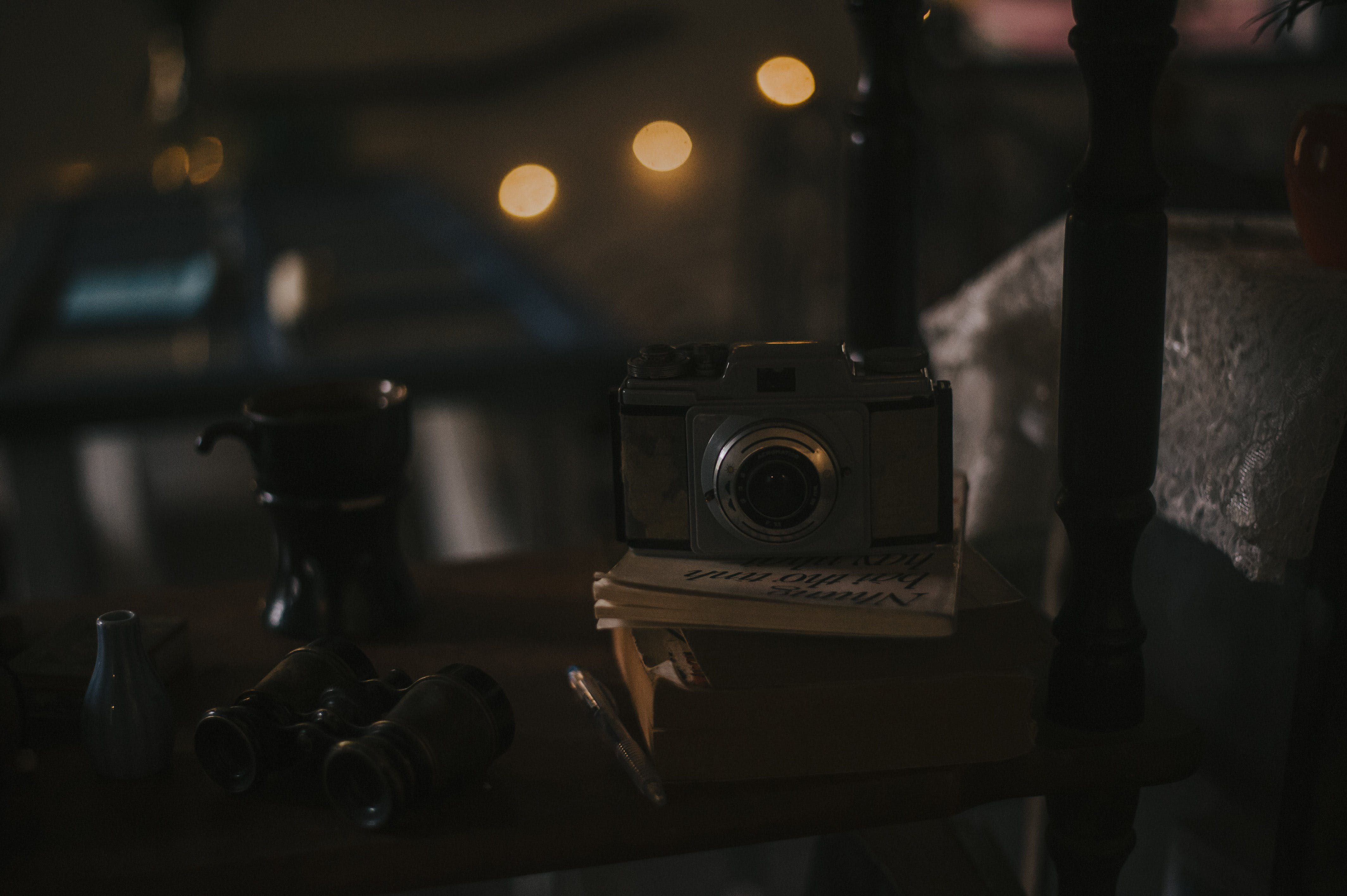 Gray Camera on White Book