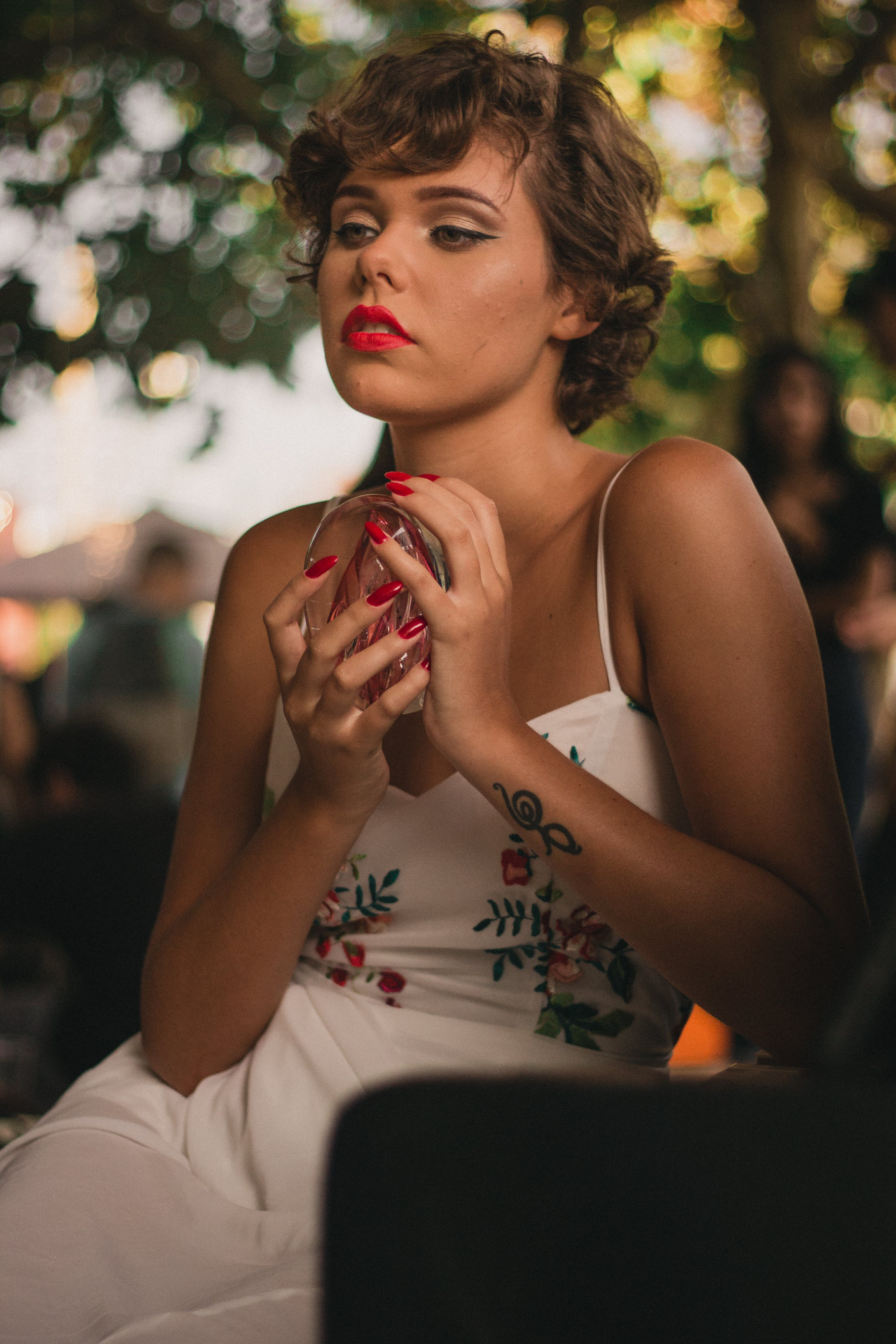 Woman in White Floral Dress