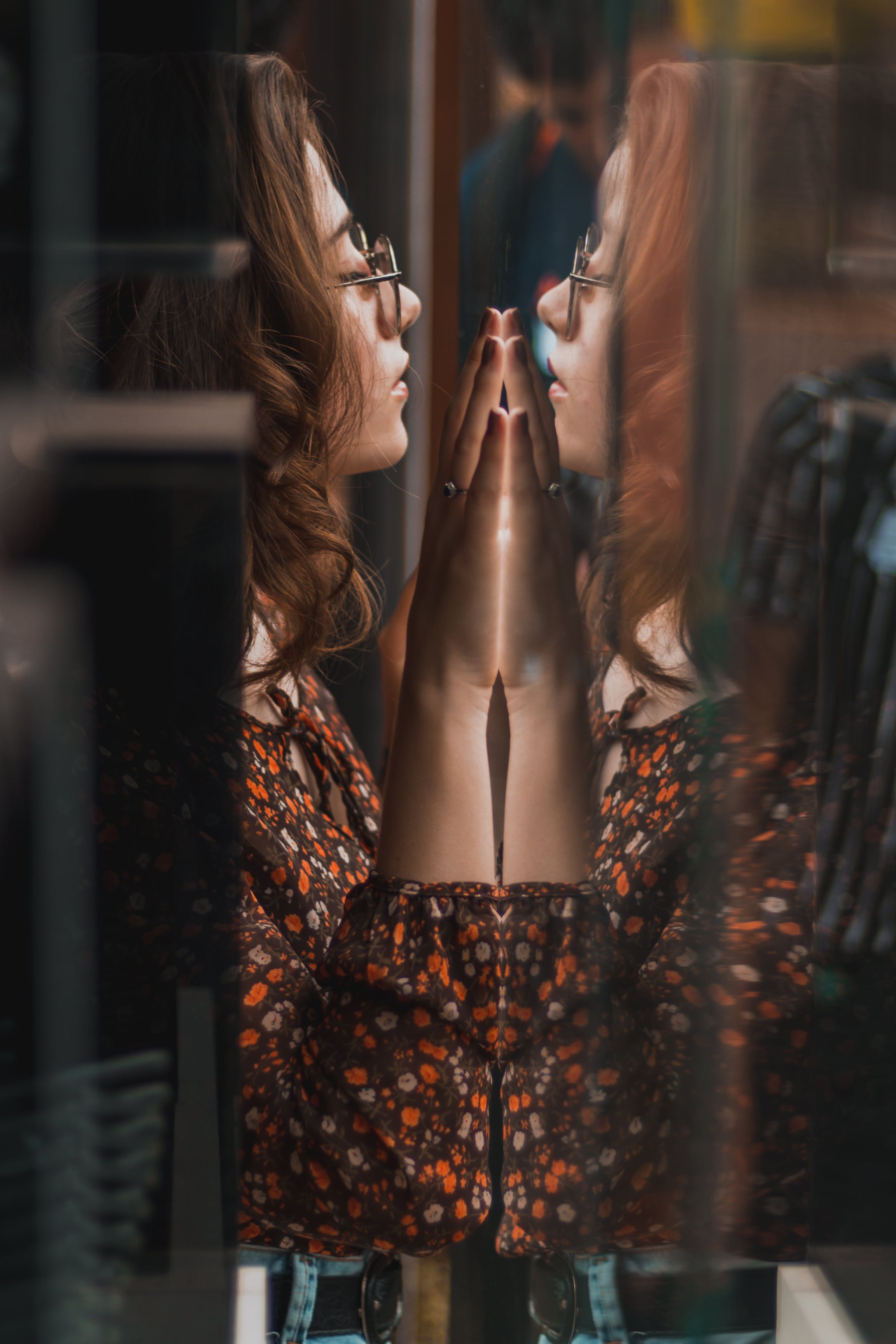 Woman With Both Hand on Glass Wall