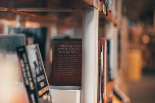 Selective Focus Photography of Books on Shelf