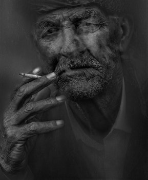 Free stock photo of black-and-white, man, person, cigarette