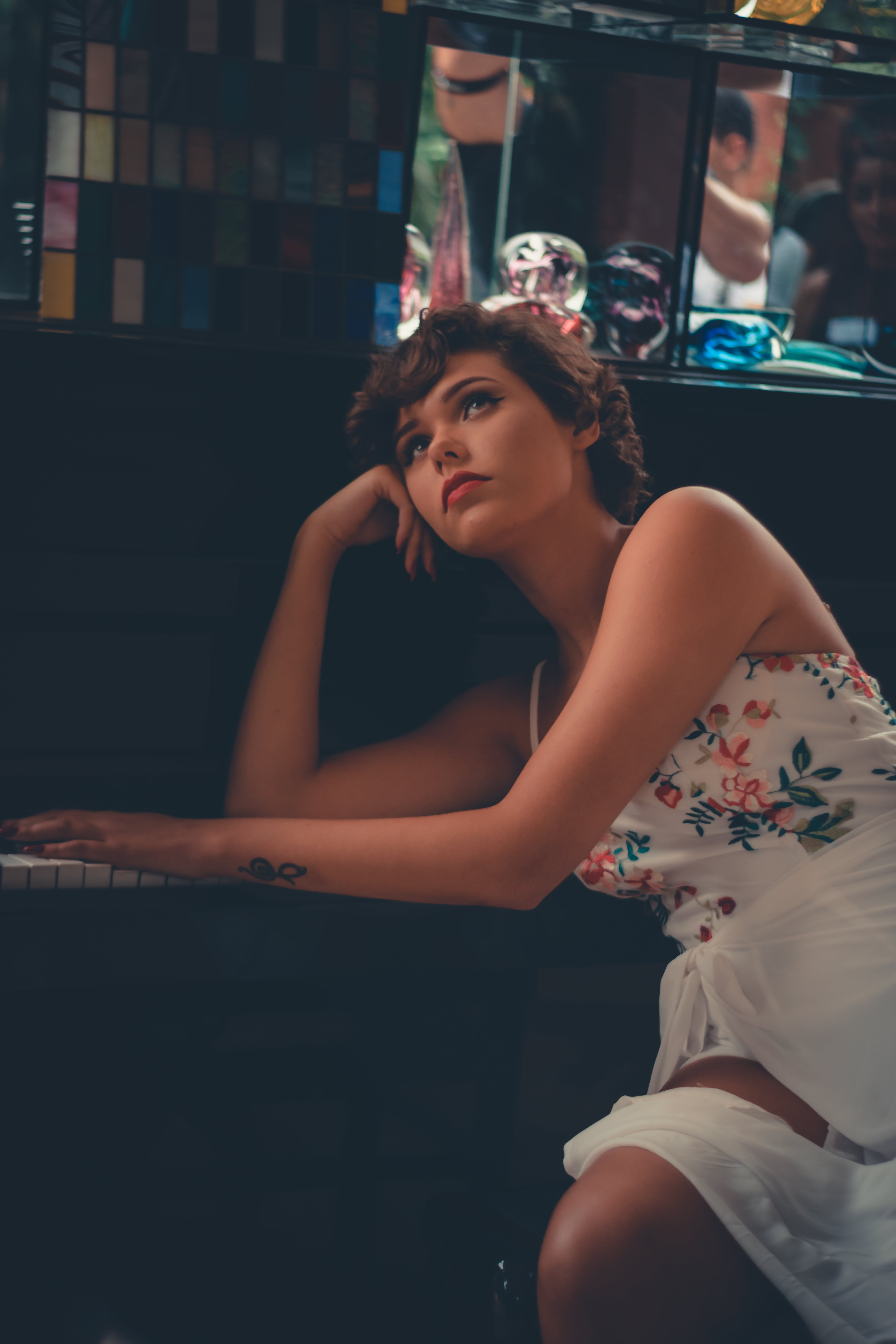Woman Leaning and Posing on Piano