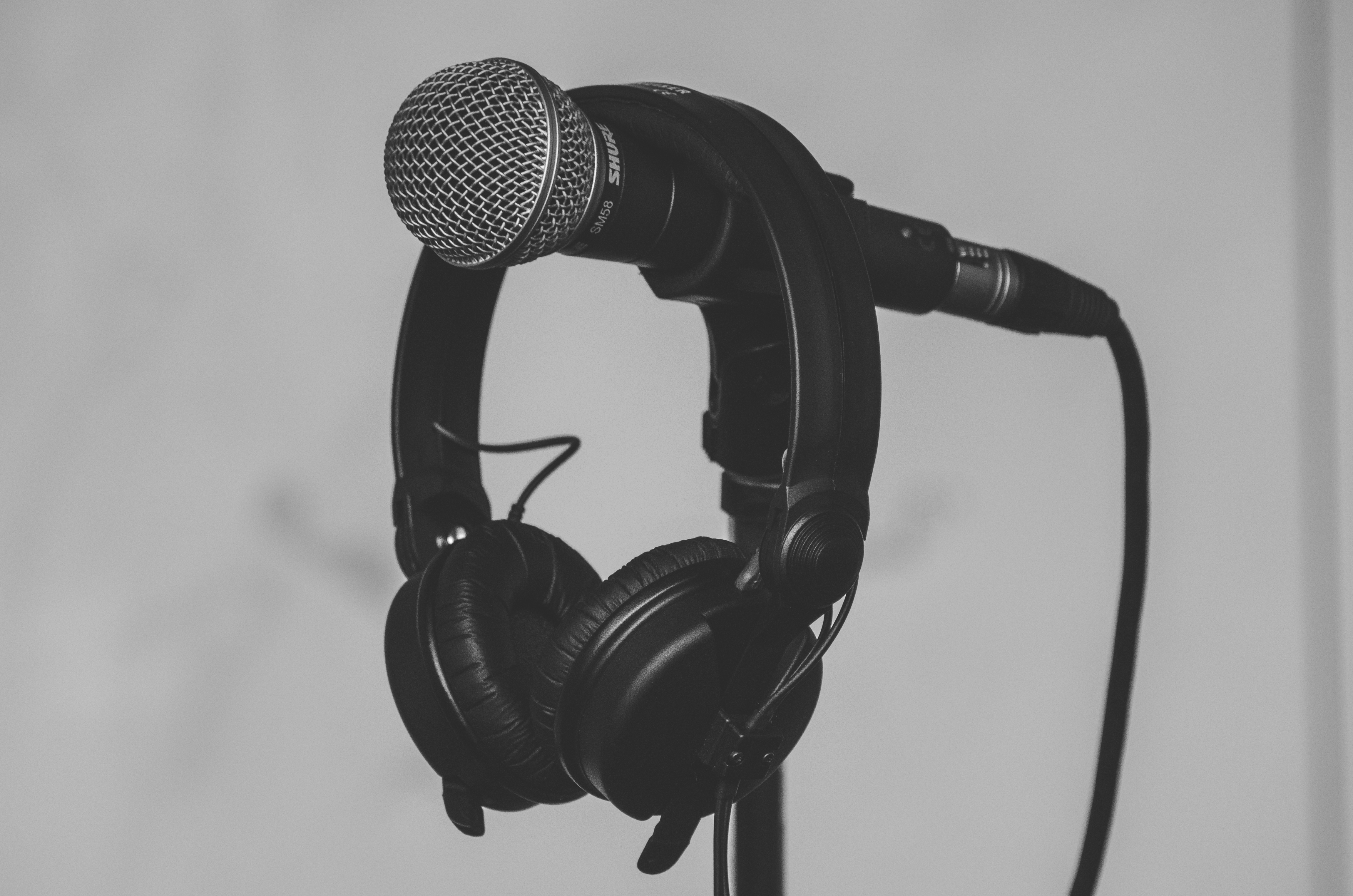 Black Headset Hanging on Black and Gray Microphone