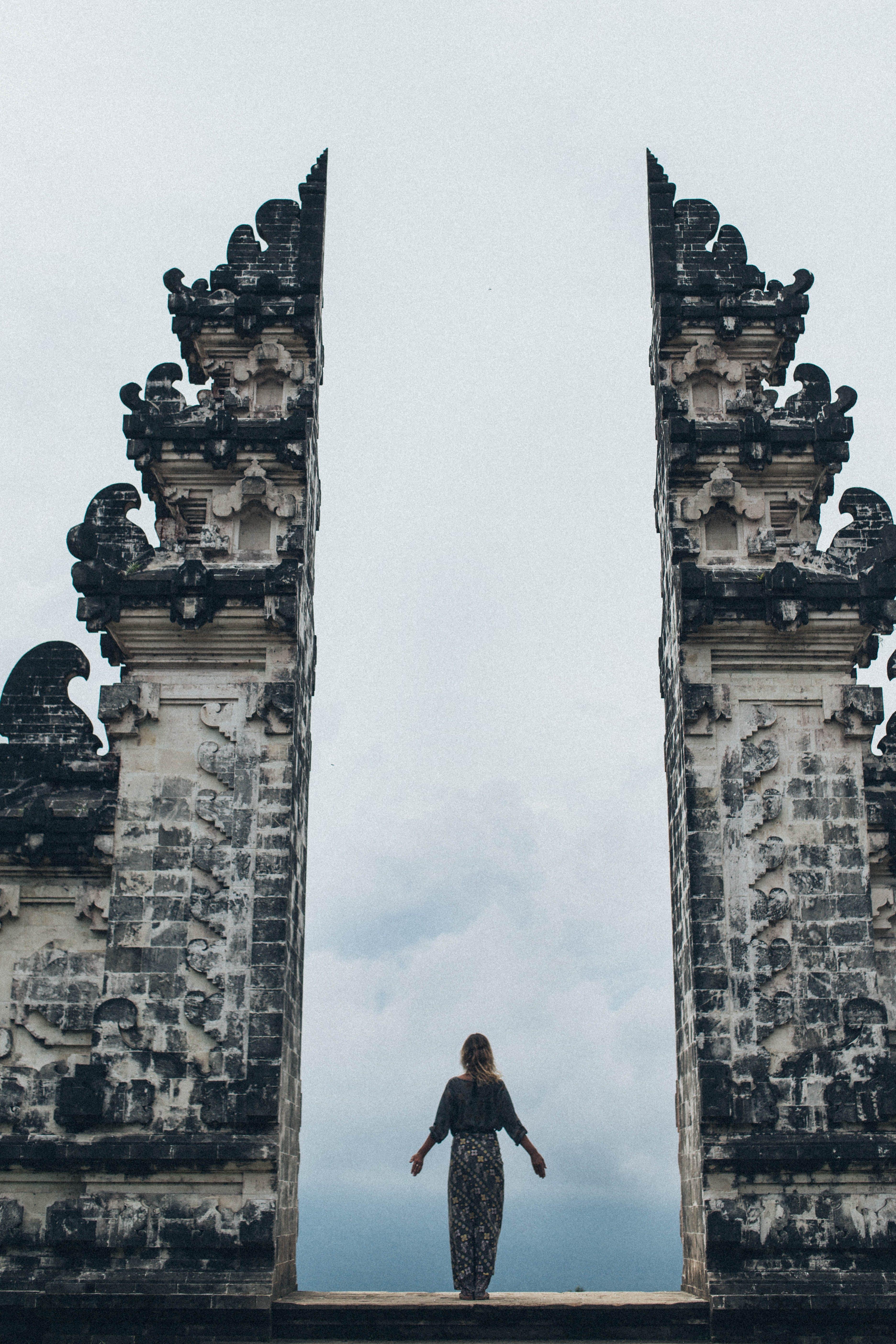 Woman Standing in Between Split Gateway