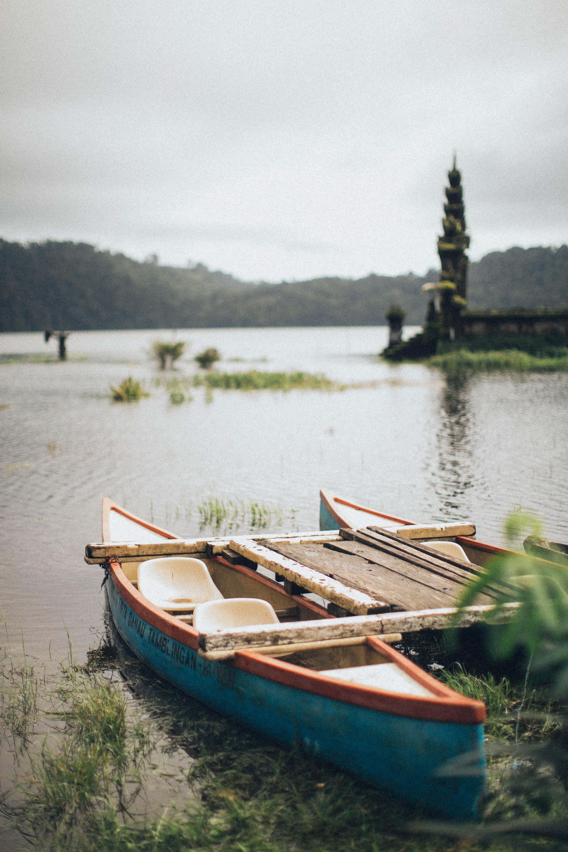 Blue Canoe on Body of Water