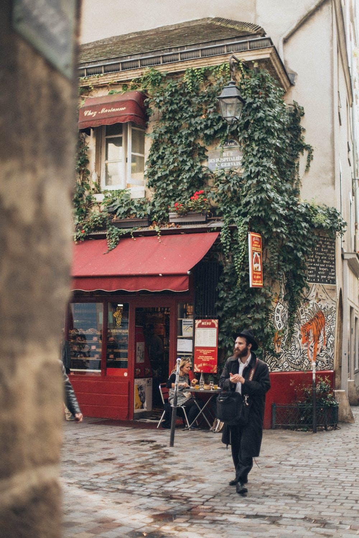A man walks near a snack bar.   Photo: Pexels