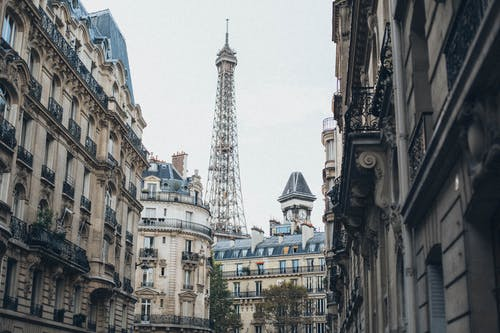 Eiffel Tower Behind Buildings