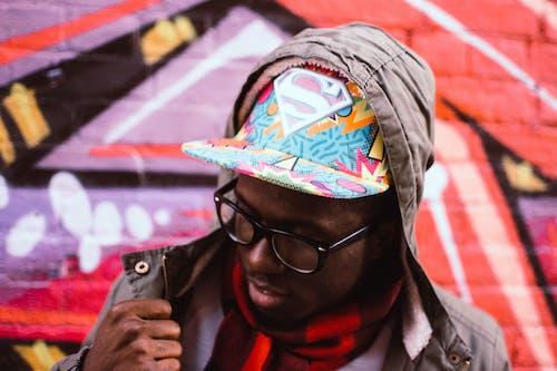 Foto profissional grátis de casaco, chapéu, Hip hop