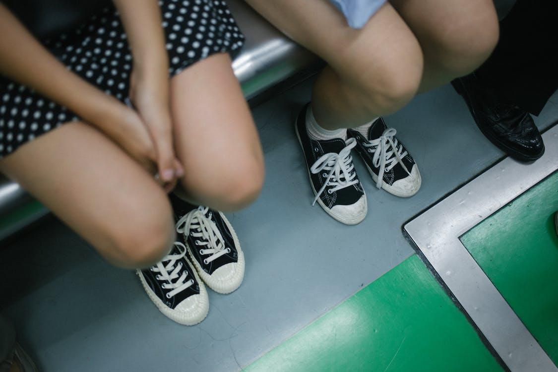 Two Women Wearing Sneakers