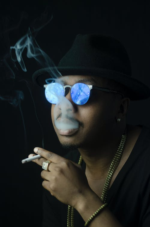Smoking Man in Black Shirt and Blue Sunglasses