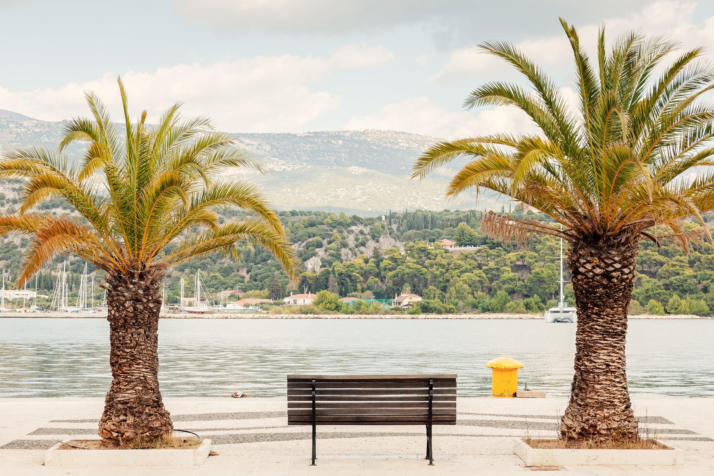 Gratis lagerfoto af både, himmel, lagune, palme