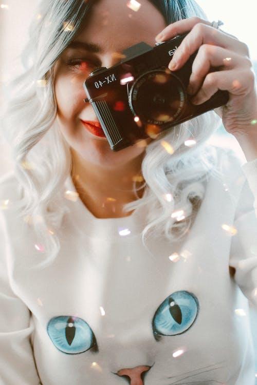 Woman Holding Camera Close-up Photo